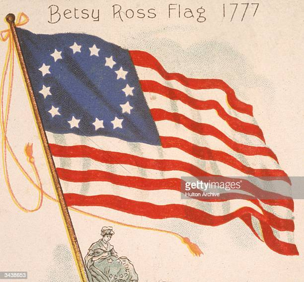 American seamstress Betsy Ross sews an American flag the first US flag adopted by Congress and the first used at the Battle of Brandywine...