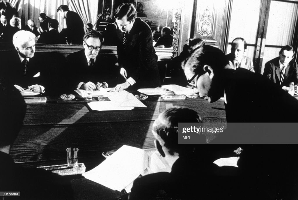 American Secretary of State Henry Kissinger and Vietnamese politician Le Duc Tho (1911 - 1990) signing the Paris peace agreement which ended the Vietnam War. Both men were awarded the Nobel Peace Prize but Le Duc Tho refused to accept it.