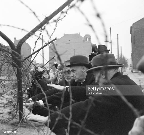 American senator Kenneth B Keating Berlin advisor of president Kennedy General Lucius D Clay and the director of the international amends committee...