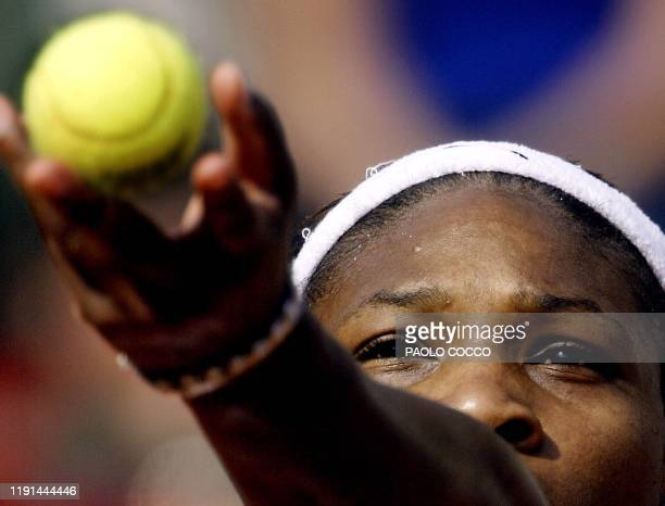 American Serena Williams serves to Conchita Martinez of Spain in a quarterfinal in the Rome Masters at Foro Italico stadium 16 May 2003 Williams won...
