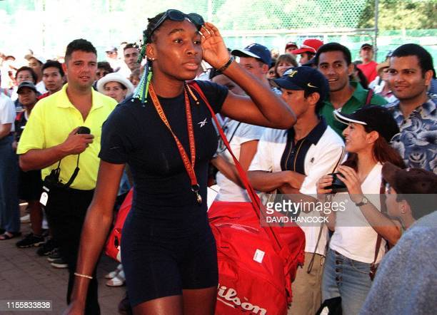 American Serena Williams walks past rows of fans on her way into the White City Stadium in Sydney 10 January. Williams is in here to compete in the...