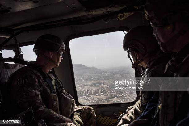 American service members deployed for Mission Resolute Support ride in a helicopter over Kabul on the way to Bagram Air Field on September 5 2017 in...
