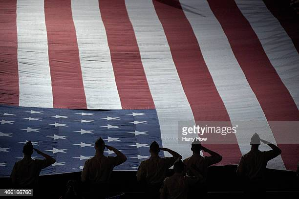 American Serviceman stand while the National Anthem is played during the Salute to Heroes cermony during the BNP Parisbas Open at the Indian Wells...