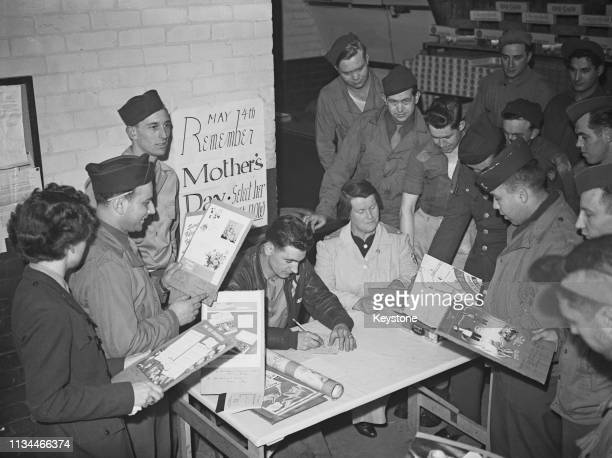 American servicemen stationed at a British airfield choosing Mother's Day gifts and placing orders at the canteen at their base April 1944