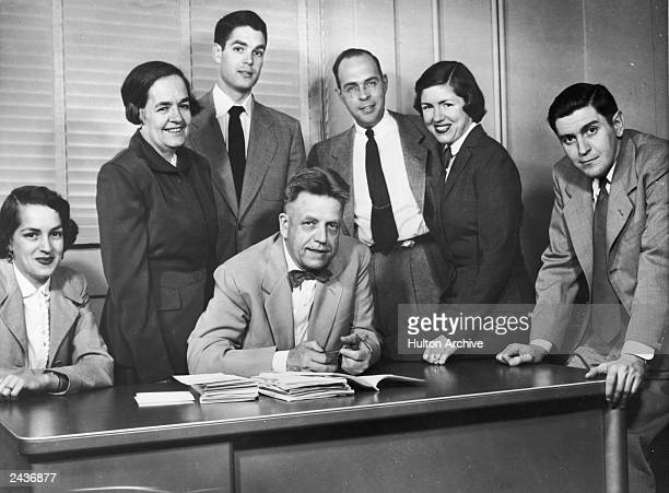 American sexuality researcher Alfred Kinsey sits at a desk surrounded by his family in Bloomington Indiana circa 1953 LR Daughter Joan Reid his wife...