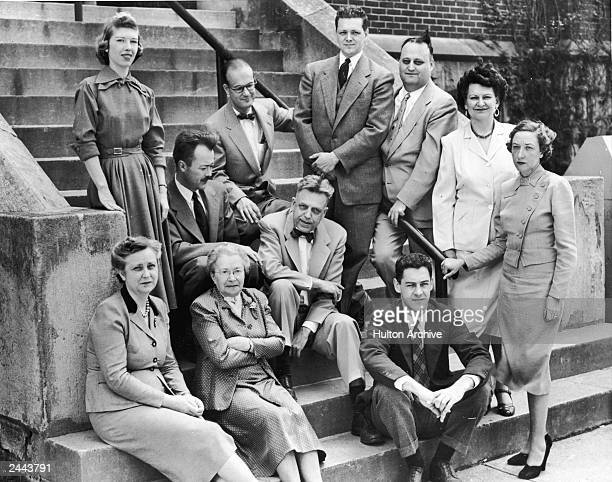 American sexuality researcher Alfred Kinsey sits with his staff members from the Indiana University Institute for Sex Research on the steps of Wylie...