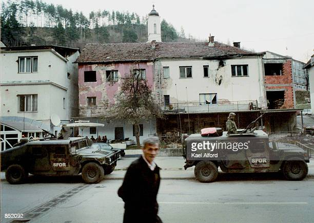 American SFOR soldiers patrol November 16, 2000 in the war-damaged city of Srebrenica, Bosnia. This year marks the fifth anniversary of the signing...