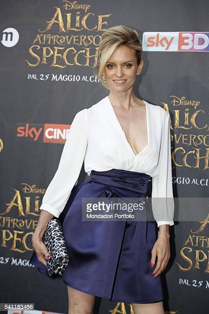American showgirl and TV presenter Justine Mattera posing on the red carpet at the national premiere of the film Alice Through the Looking Glass...