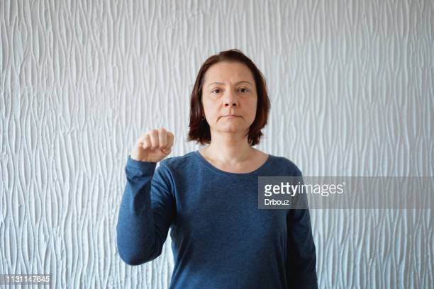 american sign language, woman showing letter m - letter m stock pictures, royalty-free photos & images