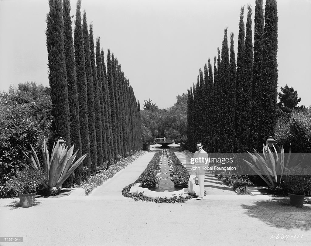 American silent era comedian Harold Lloyd (1893 - 1971) in the garden of Greenacres, his palatial Spanish-style villa in Beverly Hills, circa 1930.