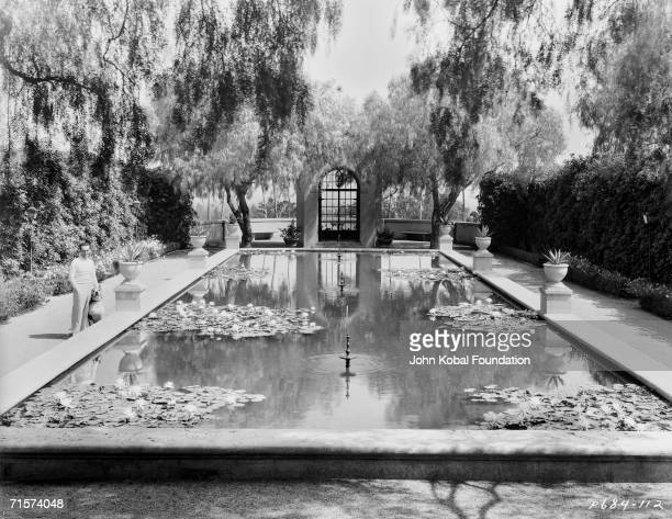 American silent era comedian Harold Lloyd in the garden of Greenacres his palatial Spanishstyle villa in Beverly Hills circa 1930