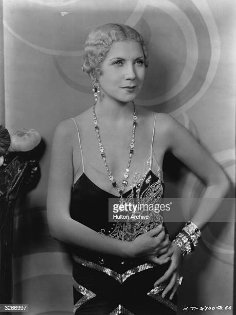 American silent star Lilyan Tashman wears a lowcut cocktail dress for the early talkie 'New York Nights' directed by Lewis Milestone for United...