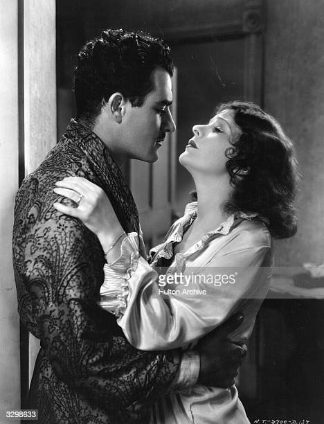 American silent star Norma Talmadge embraces Gilbert Roland in the early talkie 'New York Nights' directed by Lewis Milestone for United Artists