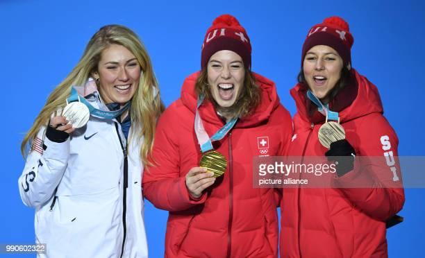 American silver medallist Mikaela Shiffrin Swiss gold medallist Michelle Gisin and compatriot bronze medallist Wendy Holdener celebrates on the...