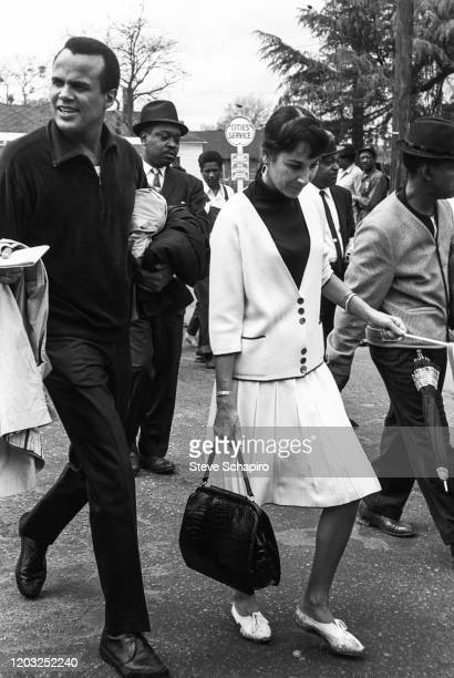 American singer actor and activist Harry Belafonte and his wife former dancer Julie Robinson march with unidentified others during the third Selma to...