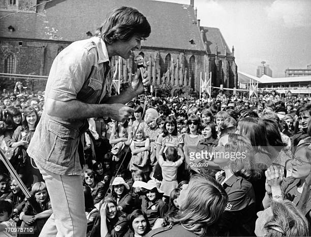 American singer, actor and director dean reed performing on an open air stage at berlin's neptune fountain during 10th free german youth parliament /...