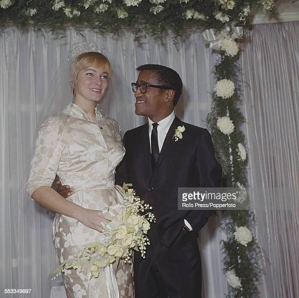 American singer actor and entertainer Sammy Davis Jr pictured with his wife Swedish actress May Britt at their wedding reception at Davis's Hollywood...