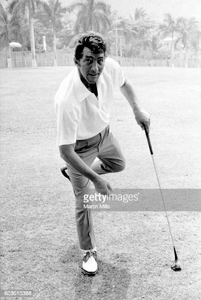 American singer actor comedian Dean Martin plays golf while on location for The Ambushers circa 1967 in Acapulco Mexico