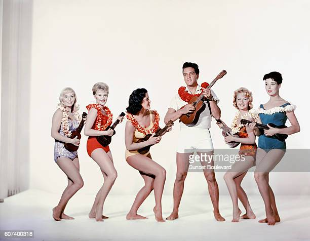 American singer actor Elvis Presley surrounded by actresses Jenny Maxwell Pamela Austin Joan Blackman Darlene Tompkins and Christian Kay on the set...