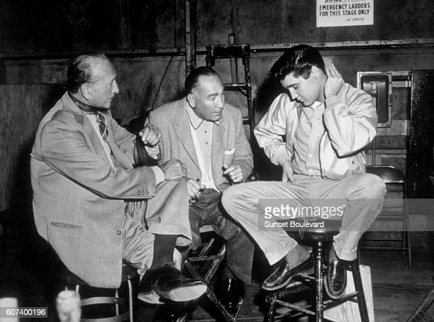 American singer actor Elvis Presley with producer Hal B Wallis and HungarianAmerican director Michael Curtiz on the set of King Creole
