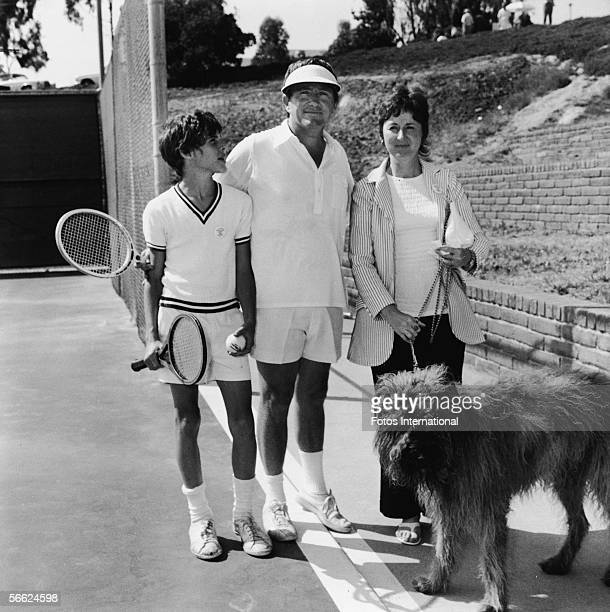 American singer actor talk show host and empresario Merv Griffin is flanked by his son Tony wife future internet quiz entrepreneur Julann and large...