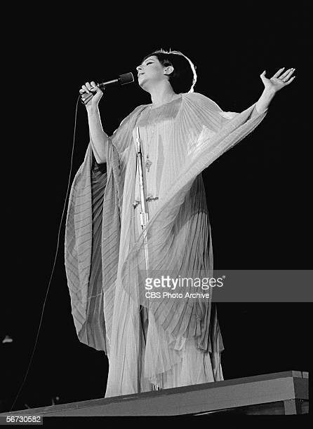 American singer actress and entertainer Barbra Streisand performs in a flowing gown at a concert in Central Park which was filmed for television as...