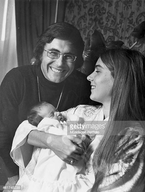 American singer actress and painter Romina Power and her husband Italian singersongwriter Al Bano smiling holding their first daughter Ylenia Italy...