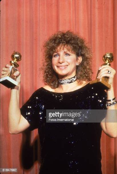 American singer actress film director and producer Barbra Streisand holds her two awards at the 41st Annual Golden Globe Awards held at the Beverly...