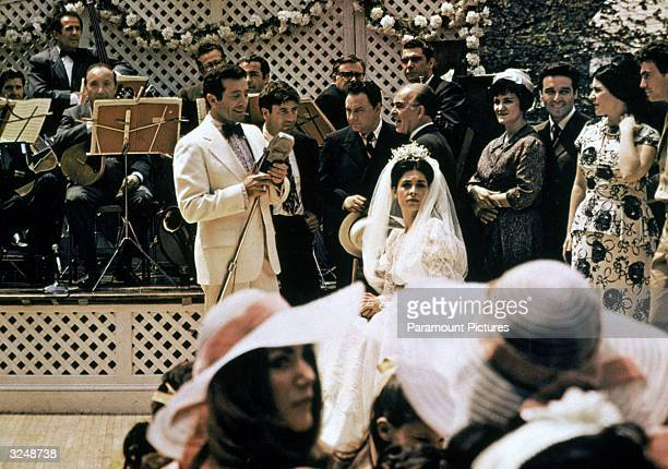 American singer Al Martino as Johnny Fontane sings to American actress Talia Shire playing the bride Constanzia in the wedding scene from director...