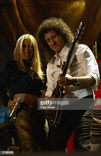 American singer Anastacia and British musician Brian May perform on stage as part of the 'Give 1 Minute to AIDS' concert for The Nelson Mandela...