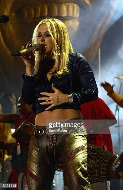 American singer Anastacia performs on stage as part of the 'Give 1 Minute to AIDS' concert for The Nelson Mandela Foundation's 46664 campaign held at...