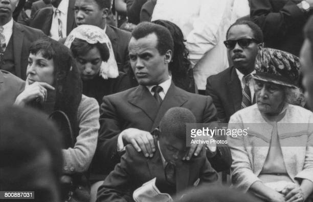 American singer and activist Harry Belafonte with his wife American dancer Julie Robinson at the funeral of assassinated American civil rights leader...