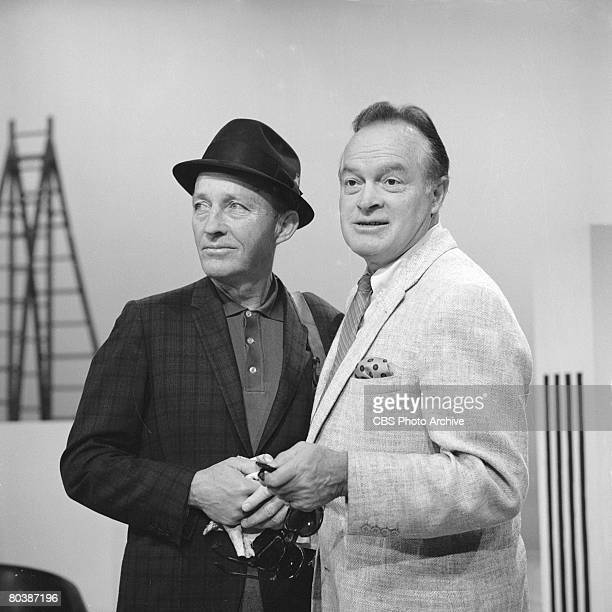 American singer and actor Bing Crosby and Britishborn American comedian and actor Bob Hope who holds two pair of sunglasses in his hand on the set of...