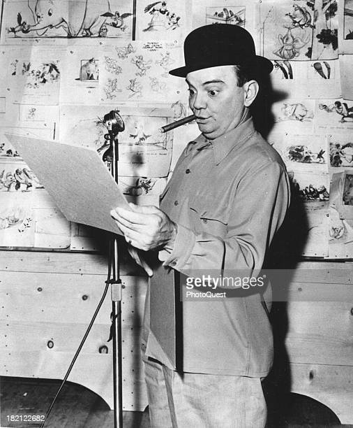 American singer and actor Cliff Edwards a bowler on his head and a cigar in his mouth records the voice for the character of Timothy Mouse in the...