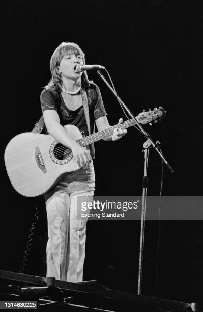 American singer and actor David Cassidy performs at White City Stadium in London, UK, 26th May 1974. 800 people were injured during the concert in a...