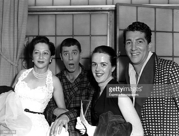 American singer and actor Dean Martin and a clowning Jerry Lewis stand with Mrs Val Parnell and Mrs Clodagh Haherty Original Publication People Disc...
