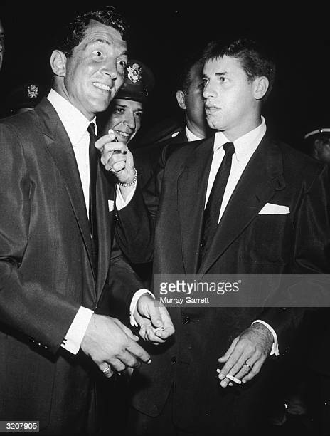 American singer and actor Dean Martin stares with a shocked expression at a person while his comedy partner American comedian and actor Jerry Lewis...