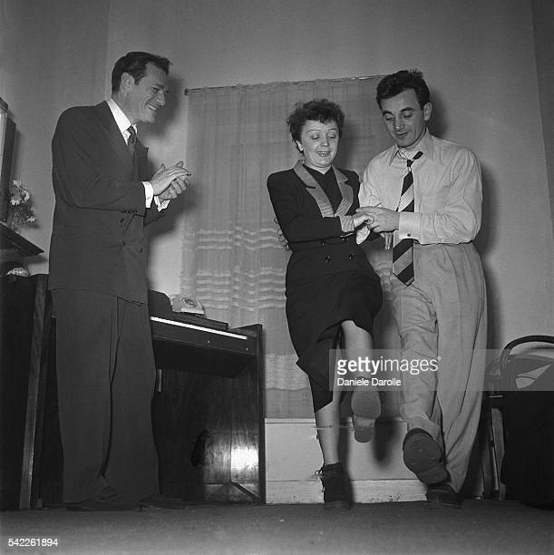 American singer and actor Eddie Constantine and French singer Edith Piaf dancing with singer and songwriter of Armenian origin Charles Aznavour