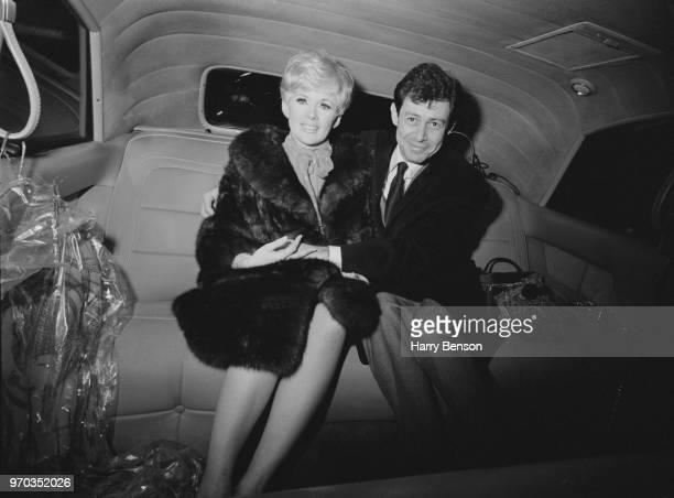 American singer and actor Eddie Fisher with his fiancee, American actress, singer and producer Connie Stevens, sitting in the back of a car after...
