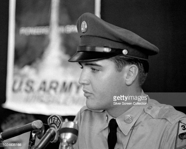 American singer and actor Elvis Presley addresses a press conference at the New York Port of Embarkation's Brooklyn Army Terminal New York City as he...