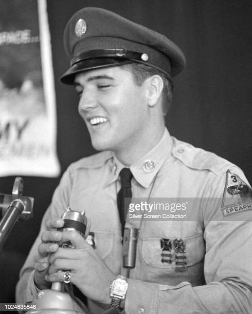 American singer and actor Elvis Presley addresses a press conference at the New York Port of Embarkation's Brooklyn Army Terminal , New York City, as...
