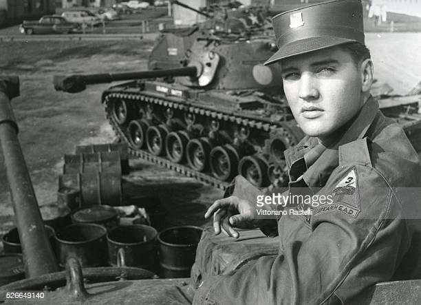"""American singer and actor Elvis Presley, aka """"The King"""", posing during his military service at a US base in Germany."""