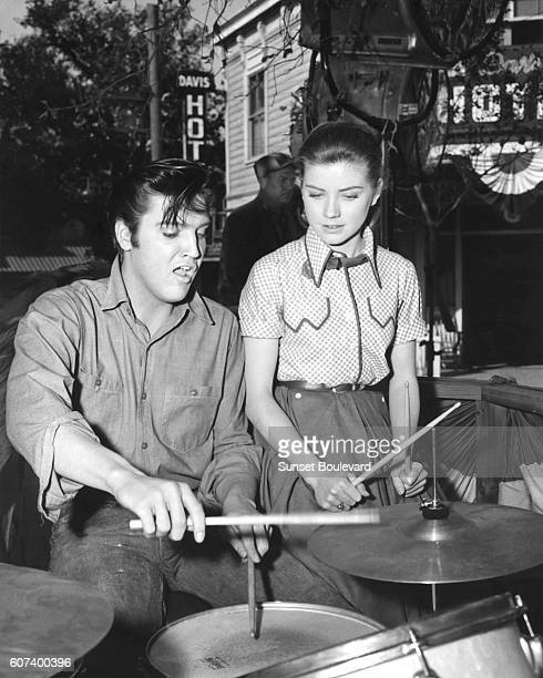 American singer and actor Elvis Presley and actress Dolores Hart on the set of Loving You, written and directed by Hal Kanter.