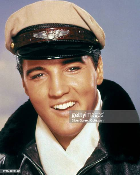 American singer and actor Elvis Presley as pilot Mike Edwards in a promotional portrait for the musical film 'It Happened at the World's Fair', 1963.