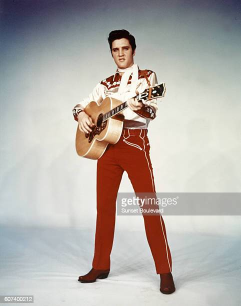 American singer and actor Elvis Presley promoting the movie Loving You written and directed by Hal Kanter