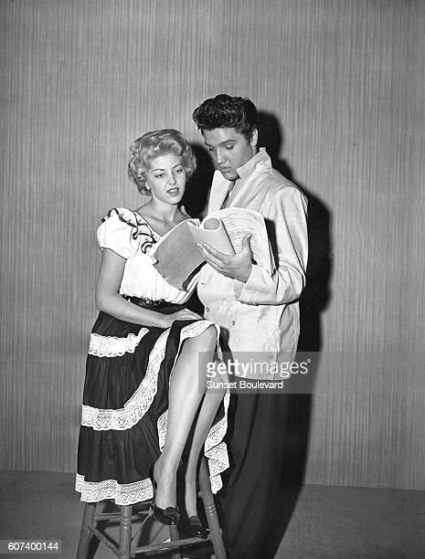 American singer and actor Elvis Presley with actress Anne Neyland on the set of Jailhouse Rock directed by Richard Thorpe