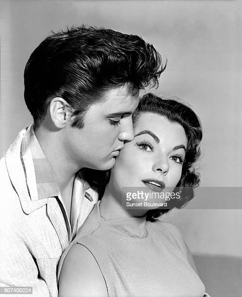 American singer and actor Elvis Presley with actress Judy Tyler on the set of Jailhouse Rock directed by Richard Thorpe