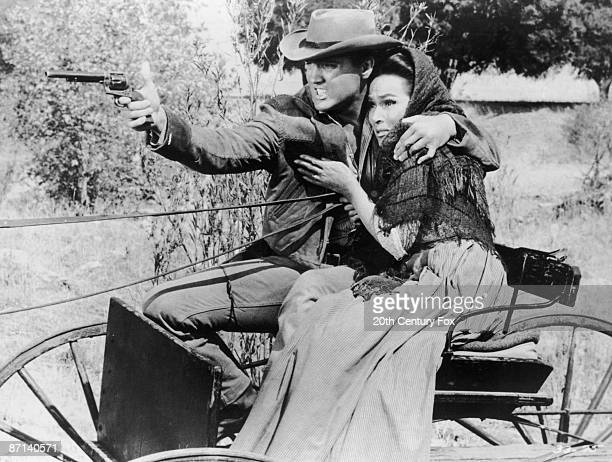 American singer and actor Elvis Presley with Dolores Del Rio in a scene from 'Flaming Star', directed by Don Seigel, 1960.