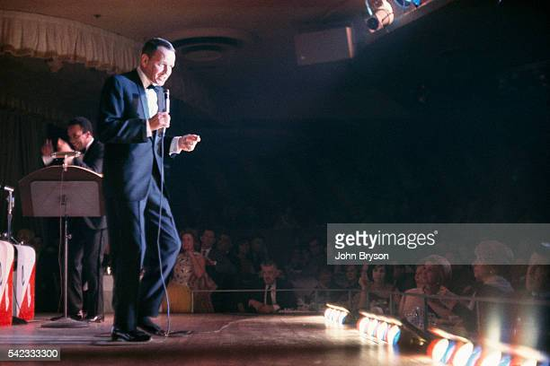 American singer and actor Frank Sinatra on stage