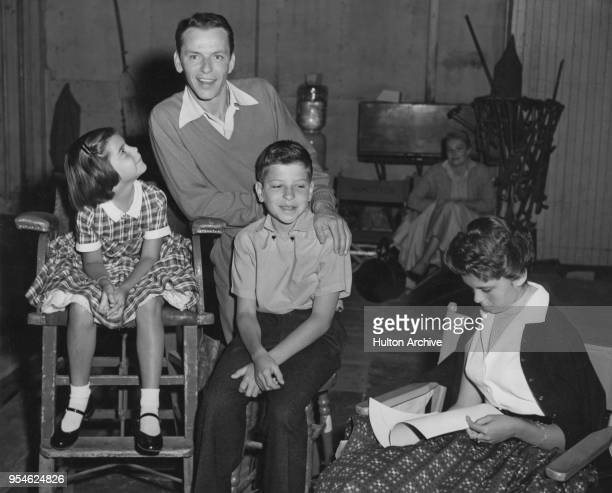 American singer and actor Frank Sinatra with his three children Christina, Nancy and Frank Jr on the set of the film 'The Tender Trap', circa 1955.